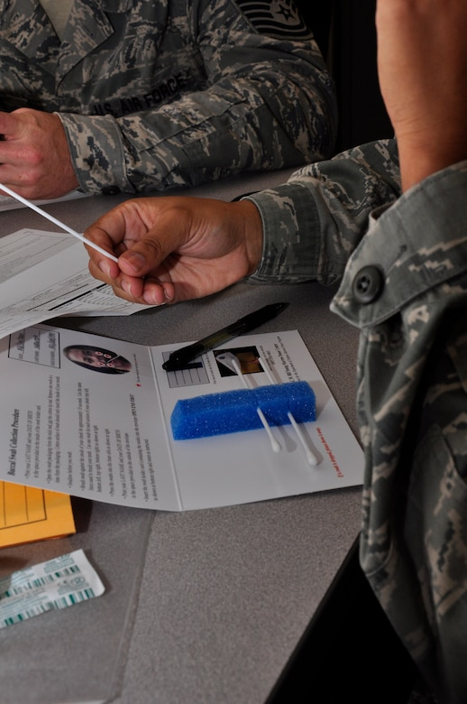 Staff Sgt. Grecille Newton, 1st Special Operations Communications Squadron Tactical Communications Flight, registers to become a bone marrow donor during a week-long bone marrow drive, Hurlburt Field, Fla., March 30, 2011. The base-wide drive, initiated by the 1st SOCS, helps support their colleague, Senior Master Sgt. Andy Turnbull, Tactical Communications Flight superintendent, who was diagnosed with acute myeloid leukemia July 19, 2010. (U.S. Air Force photo by Staff Sgt. William Banton/RELEASED)