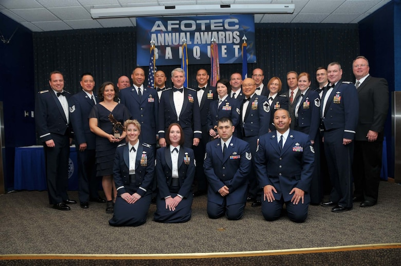 Air Force Operational Test and Evaluation Center Commander Maj. Gen. David J. Eichhorn (center row, third from left) joins outstanding AFOTEC performers from 2010 that were honored during the March 24 AFOTEC Annual Awards Banquet.