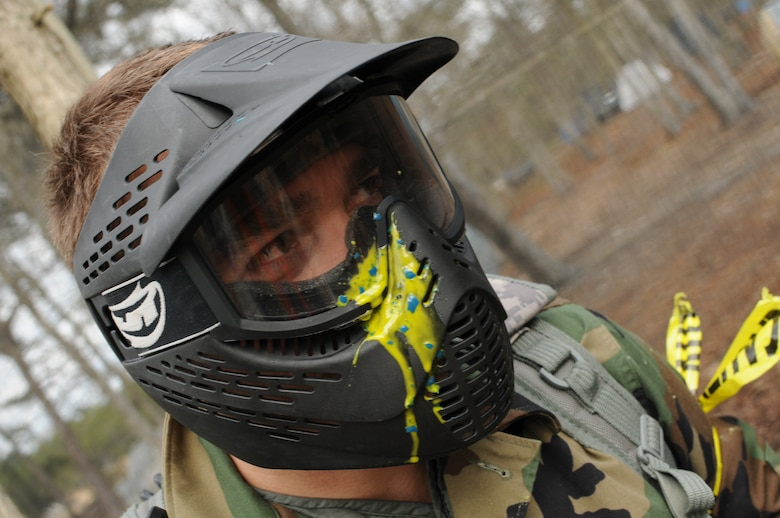 Airman First Class Luiz Vicentini of the 102nd Intelligence Wing Public Affairs office got hit in the face mask with a paintball during the May UTA Commanders Cup paintball tournament.