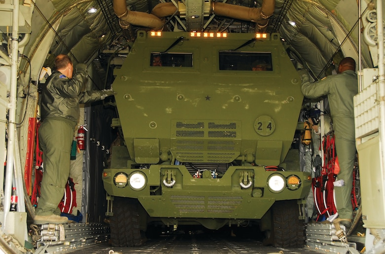 The 908th Airlift Wing recently teamed with the U.S. Army and Lockheed Martin to help increase transport capabilities involving a High Mobility Artillery Rocket System (HIMARS, an artillery rocket platform mounted on a five-ton truck. Above, Staff Sgt. Chris Wild and Master Sgt.Johnny Montgomery guide the HIMARS into final position.