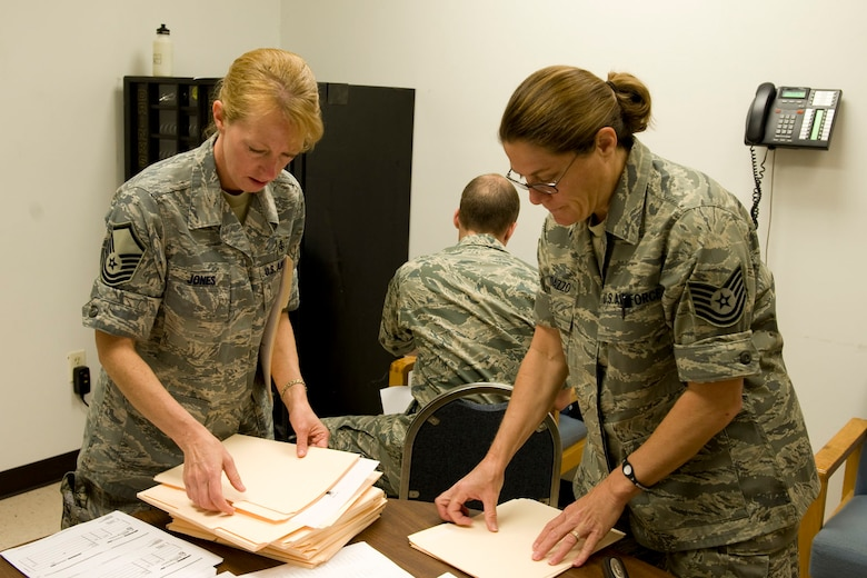 HAYNEVILLE, Ala. - Master Sgt. Pauline Jones, a medical logistics technician, from the 176th Medical Group, Alaska Air National Guard and Tech. Sgt. Jan Randazzo, a medical administration technician, from the 131st Medicial, Missouri Air National Guard prepare patient forms, May 3, 2011.  Jones and Randazzo are in Alabama for an Innovative Readiness Training (IRT) mission. The IRT program allows for real world training opportunities for military personnel while providing needed services to under-served communities in the United States. Alaska Air National Guard photo by Master Sgt. Shannon Oleson.