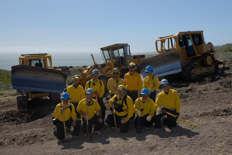 VANDENBERG AIR FORCE BASE, Calif. -- Members from the 30th Civil Engineer Squadron Fire Dozer Academy training pose for a photo here Thursday, April 28, 2011.  The 30th CES fire dozer team  works with the 30th CES fire fighters to stop the spread of brush fires.  (U.S. Air Force photo/Staff Sgt. Andrew Satran)