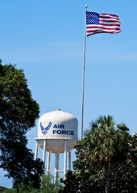 The American flag flies high above the Air Armament Center headquarters at Eglin Air Force Base, Fla.  Eglin personnel and visitors are reminded to pay respect to the flag during Reveille at 7:30 a.m. and Retreat at 5 p.m. each day.  (U.S. Air Force photo/Samuel King Jr.)