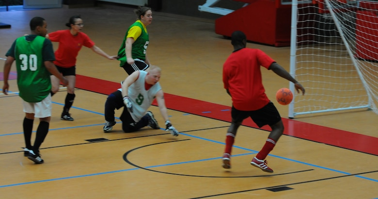 SPANGDAHLEM AIR BASE, Germany – Airmen from the 52nd Civil Engineer Squadron score against the 52nd Medical Group during an intramural soccer game at the Skelton Memorial Fitness Center here April 28. The 52nd CES defeated the 52nd MDG 6-2. (U.S. Air Force photo/Airman 1st Class Dillon Davis)