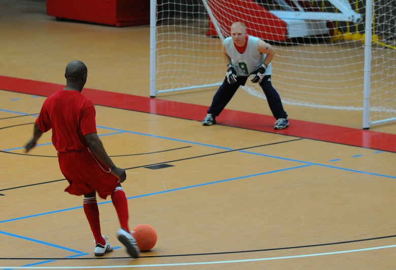 SPANGDAHLEM AIR BASE, Germany – Alfred Doby, 52nd Aerospace Medical Squadron, warms up before a soccer game at the Skelton Memorial Fitness Center here April 28. The 52nd Civil Engineer Squadron defeated the 52nd Medical Group 6-2. (U.S. Air Force photo/Airman 1st Class Dillon Davis)