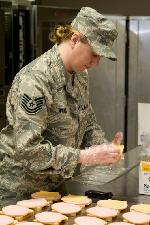 DANNELLY FIELD, Ala. - Tech. Sgt. Trisha Willis, services technician from 176th Sustainment Services Element, Alaska Air National Guard, prepares sandwiches for box lunches, May 5, 2011. Willis was at Danelly Field, Ala. to borrow the kitchen of the 187th Fighter Wing to make lunches for a group of deployers who were working out of Hayneville, Ala. There were about 70 deployers from numerous military components and services in Hayneville for an Innovative Readiness Training (IRT) mission. The IRT program allows for real world training opportunities for military personnel while providing needed services to under-served communities in the United States. Alaska Air National Guard photo by Master Sgt. Shannon Oleson.