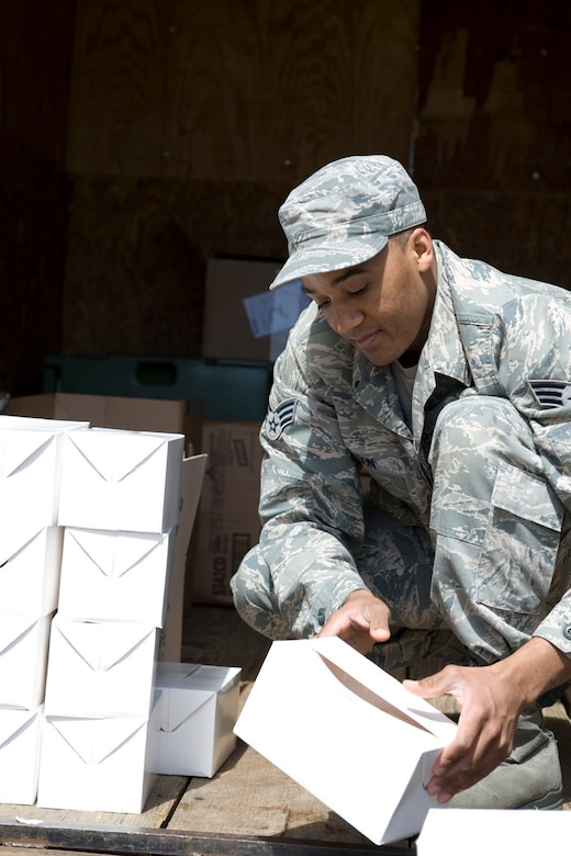 DANNELLY FIELD, Ala. - Senior Airman Allen Wilson, a services technician from the 176th Sustainment Services Element, Alaska Air National Guard, packs box lunches into a delivery truck, May 5, 2011. Wilson was at Danelly Field, Ala. to borrow the kitchen of the 187th Fighter Wing to make lunches for a group of deployers who were working out of Hayneville, Ala. There were about 70 deployers from numerous military components and services in Hayneville for an Innovative Readiness Training (IRT) mission. The IRT program allows for real world training opportunities for military personnel while providing needed services to under-served communities in the United States. Alaska Air National Guard photo by Master Sgt. Shannon Oleson.