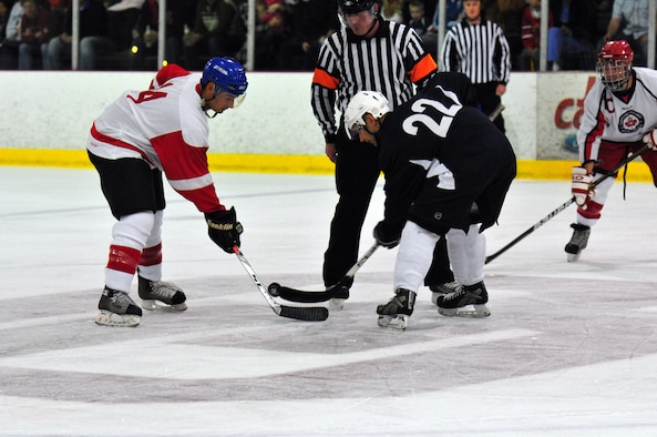 Canadian player Kyle Bostic, left, faces off against Derrick Iwanenko after the Americans scored to cut the Canadian lead in half during the 2011 CAN/AM Cup. The American Component of the 552nd Air Control Wing skated home with a 6-3 victory in the third annual contest, which was played April 29 at the Blazers Ice Center in south Oklahoma City. (Courtesy photos)
