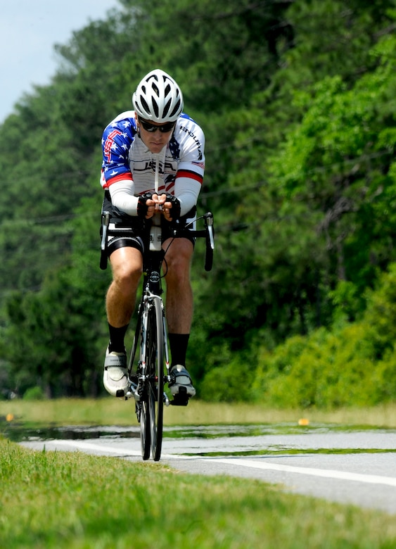 HAHIRA, Ga.-- Jason Rogers, Air Force veteran, cycles through Georgia's heat and humidity as he nears the finish of his 2,500 mile trip across country May 2. Mr. Rogers was a liquid fuel systems maintenance specialist during operations Desert Storm and Shield and decided to ride to raise money for wounded veterans through the Wounded Warrior program. (U.S. Air Force photo/Airman 1st Class Benjamin Wiseman)(RELEASED)