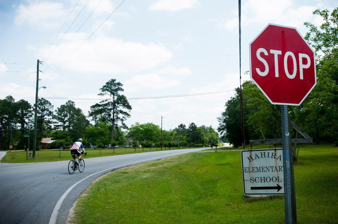 HAHIRA, Ga.-- Jason Rogers, Air Force veteran , rides his bicycle along highway road 122 to the town of Waycross, Ga. on his journey across the United States May 2. Mr. Rogers traveled across the U.S. to raise money for the Wounded Warrior program. (U.S. Air Force photo/Airman 1st Class Benjamin Wiseman)(RELEASED)