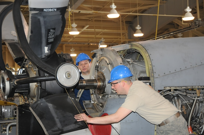 107th Maintenance personnel from the Propulsion shop intalll a the Allison T56 is a single shaft, modular design military turboprop on the C-130 aircraft on May 4, 2011. TSgt Aaron Clause and TSgt Dan Weiser guide the prop on the T56 engine.(Air Force Photo/SMSgt Ray Lloyd)