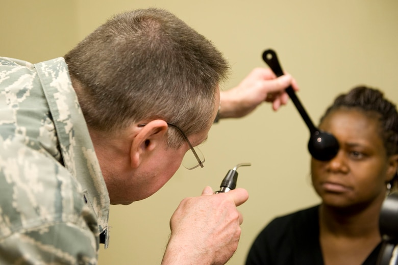 HAYNEVILLE, Ala. - Col. Ronald Kichura, an optometrist from and commander of the 176th Medical Group, Alaska Air National Guard, performs a cover test to check his patient?s eye alignment, May 3, 2011. Kichura and about 35 other members from the 176th Wing are in Alabama for an Innovative Readiness Training (IRT) mission. The IRT program allows for real-world training opportunities for military personnel while providing needed services to under-served communities in the United States. Alaska Air National Guard photo by Master Sgt. Shannon Oleson.