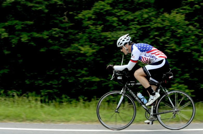 Jason Rogers, an Air Force veteran, rides his bicycle May 2, 2011, through Hahira, Ga. Mr. Rogers rode his bicycle 2,500 miles across the U.S., to raise money for the Wounded Warrior Project. (U.S. Air Force photo/Airman 1st Class Jarrod Grammel)