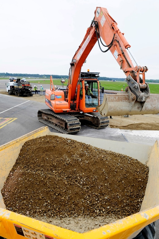 RAF MILDENHALL, England -- David Dodge, a local contractor, uses a 14