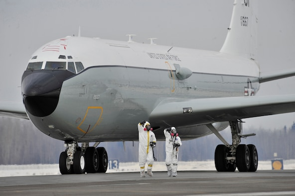 """EIELSON AIR FORCE BASE, Alaska -- Personnel from the 55th Aerospace Medicine Squadron and 55th Aircraft Maintenance Squadron report a """"thumbs down,"""" which indicates the WC-135 Constant Phoenix aircraft is above acceptable levels of contamination and needs be parked in an isolated location to be decontaminated. This initial radiation survey was done every time the WC-135 landed after collecting air samples in international airspace over the Pacific as part of Operation Tomodachi. (Air Force photo by Staff Sgt. Christopher Boitz)"""