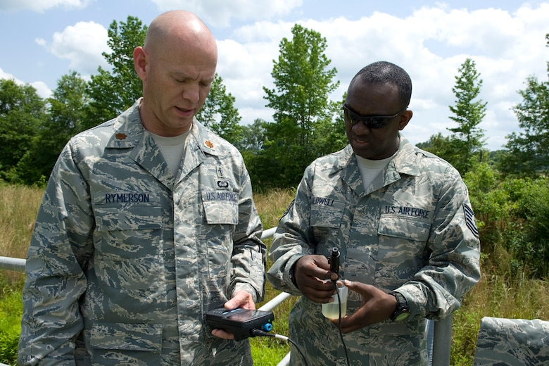 HAYNEVILLE, Ala. - Maj. Rick Rymerson, a  a bioenvironmental engineer with the 176th Medical Group, Alaska Air National Guard, and Tech. Sgt. Dainard Caldwell, a public health technician with group, test a ample of water from the City of Hayneville?s waste-water treatment lagoon for it pH balance, May 8, 2011.  Rymerson and Caldwell were in Alabama to help test the waste water for permit compliance and related treatment adjustments, and with drinking water for chlorine amount. They were also deploy with another seventy servicemembers from numerous military components and services in Hayneville for an Innovative Readiness Training (IRT) mission. The IRT program allows for real world training opportunities for military personnel while providing needed services to under-served communities in the United States. Alaska Air National Guard photo by Master Sgt. Shannon Oleson.