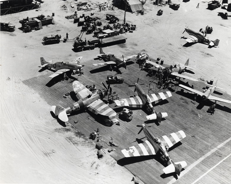 P-51s and P-47s undergo maintenance at Lingayen airstrip in the Philippines in April 1945. (U.S. Air Force photo)
