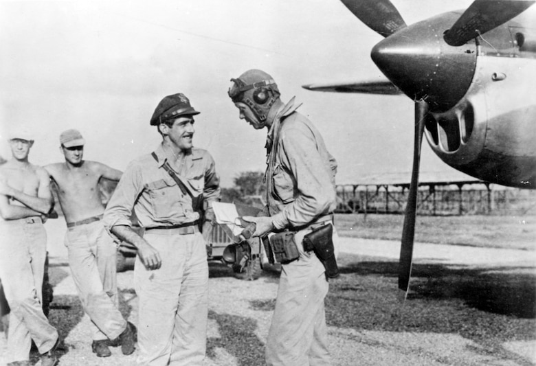 Famed aviator Charles A. Lindbergh with Maj. Thomas B. McGuire (left). During the summer of 1944, Lindbergh visited the Southwest Pacific Theatre and devised economical flight techniques to extend the range of P-38 fighters. (U.S. Air Force photo)