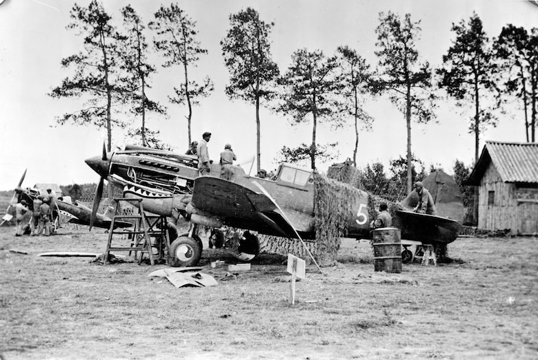Repairing a Flying Tiger P-40 at Kunming, China. (U.S. Air Force photo)