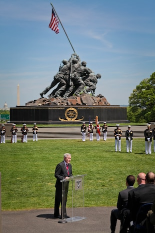Secretary of the Navy Ray Mabus presents the Navy Cross to Gunnery Sgt. Brian M. Blonder during a ceremony at the Marine Corps War Memorial in Arlington, Va., May 10, 2011. Blonder received the second highest award given for valor in the face of danger for his actions during an all-day firefight against Taliban insurgents Aug. 8, 2008, during the battle of Shewan, Afghanistan. Although he and the Marines and sailors he was fighting alongside with were outnumbered against insurgents, they managed to kill more than 50 and drove the rest out of their fortified fighting positions in the Taliban infested village in southern Farah province. Blonder, a reconnaissance Marine by trade, was serving as platoon sergeant with a force reconnaissance platoon attached to 2nd Battalion, 7th Marine Regiment.