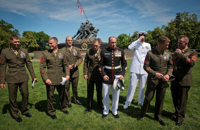 Marines with 1st Reconnaissance Battalion joined Gunnery Sgt. Brian M. Blonder at the Marine Corps War Memorial in Arlington, Va., May 10, 2011, when he was awarded the Navy Cross. Blonder, a reconnaissance Marine, received the second highest award given for valor in the face of danger for his actions during an all-day firefight against Taliban insurgents Aug. 8, 2008, during the battle of Shewan, Afghanistan. Although he and the Marines and sailors he was fighting alongside with were heavily outnumbered against insurgents, they managed to kill more than 50 insurgents and drove the rest out of their fortified fighting positions in the Taliban infested village in southern Farah province. Blonder was serving as platoon sergeant with a force reconnaissance platoon attached to 2nd Battalion, 7th Marine Regiment. From left to right, Sgt. David Nisbeth, Sgt. Erik Loyd, Gunnery Sgt. Thomas Hartrick, Gunnery Sgt. John Rosenberg, Gunnery Sgt. Brain Blonder, Chief Petty Officer Joe Martin, Gunnery Sgt. Garrett Dean and Gunnery Sgt. Craig Wheeler all fought in the battle of Shewan.