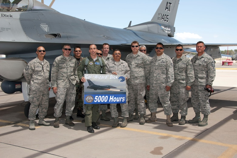 "Col. Lenny Dick accepts a poster May 9 commemorating his 5,000th F-16 Fighting Falcon flying hour from aircraft maintainers assigned to the 162nd Fighter Wing. Known as ""F"" Flight, the team supports the Air National Guard Air Force Reserve Command Test Center with regular maintenance as well as unique test modifications. Since he arrived in Tucson in 2005, Colonel Dick has never experienced an in-flight emergency. (U.S. Air Force photo/Master Sgt. Dave Neve)"