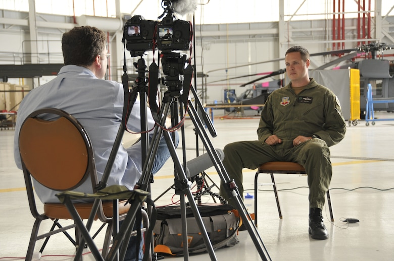 "Maj. Mathew Wenthe, an HH-60G Pave Hawk helicopter pilot with the 129th Rescue Squadron, is interviewed by David Scantling, a film director and producer for Waltzing Matilda Films, regarding an August 26, 2009 rescue mission in Afghanistan involving Marines from 1st Battalion, 5th Marines. The interview if for a documentary called ""Patrol Base Jaker.""  (Air National Guard photo by Tech. Sgt. Ray Aquino)"