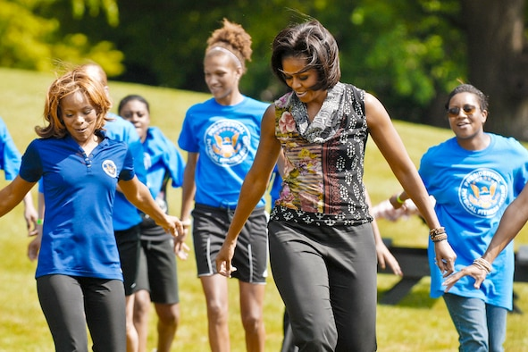 First Lady Michelle Obama shows off her dance moves during a fitness and nutrition event May 9, 2011, at the White House. The first lady and a group of about 80 National Guard and Reserve teens tried out several fitness and nutrition stations scattered across the South Lawn.  (DOD photo/Elaine Sanchez)