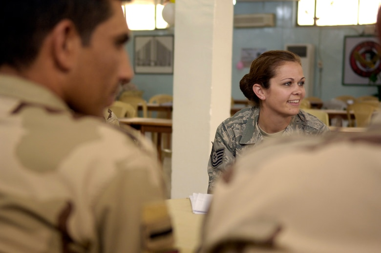 """Tech. Sgt. Rebecca McKeever discusses the Air Force core value of """"Integrity First"""" with a group of junior Iraqi airmen during a NCO professional development course April 27, 2011. U.S. Airmen with the Iraq Training and Advisory Mission-Air and 447th Air Expeditionary Group taught the course to help the Iraqi air force develop its NCOs into stronger leaders. Sergeant McKeever, originally from Winchester, Va., is deployed from Buckley Air Force Base, Colo. Sergeant McKeever is the 447th Expeditionary Medical Squadron NCO in charge. (U.S. Air Force photo/Tech. Sgt. Randy Redman)"""