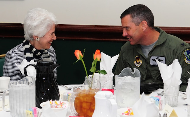 RAF LAKENHEATH, England -- Eva Clarke, a Holocaust survivor, chats with Col. Bill Lewis, 48th Fighter Wing vice commander, at the Holocaust Remembrance Week luncheon May 6, 2011. Mrs. Clarke, whose parents were kept prisoner in concentration camps during the war, solely because they were Jewish, spoke at the luncheon as part of the Holocaust Remembrance Week events. She was born on the back of a coal truck, three days before the U.S. Army liberated the camp. (U.S. Air Force photo/Karen Abeyasekere)