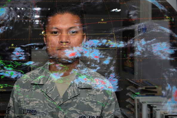 Staff Sgt. Paul Alfred, 36th Operations Support Squadron weather forecaster, poses in front of a thermal infrared satellite feed of the Pacific Region here May 11. Sergeant Alfred was recently awarded 2010's Weather Noncommissioned Officer of the Year at the Air Force level for showing outstanding initiative and leadership ability. (U.S. Air Force photo/Senior Airman Carlin Leslie)