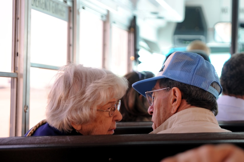 Married for more than 60 years, Bill McKarns and his wife share a moment during the bus ride to the static C-17 on Joint Base Charleston, May 5. Mr. McKarns was a World War II Hump pilot assigned to the U.S. Army Air Force's Air Transport Command and flew from India into China, transporting trucks, weapons and supplies in support of Chinese soldiers. (U.S. Air Force photo/ Staff Sgt. Nicole Mickle)  (Released)
