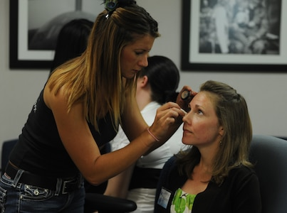 Shelly Rucker has her make-up done by a volunteer professional make-up artist at the Military Spouses' Appreciation Tea on Joint Base Charleston, May 7. The Tea was sponsored by the Airmen and Family Readiness Center to show appreciation for military spouses. The event included giveaways, make-overs, crafts and a special appearance by Terry Serpico, who plays Col. Frank Sherwood on the television series Army Wives.  (U.S. Air Force photo/ Staff Sgt. Nicole Mickle)