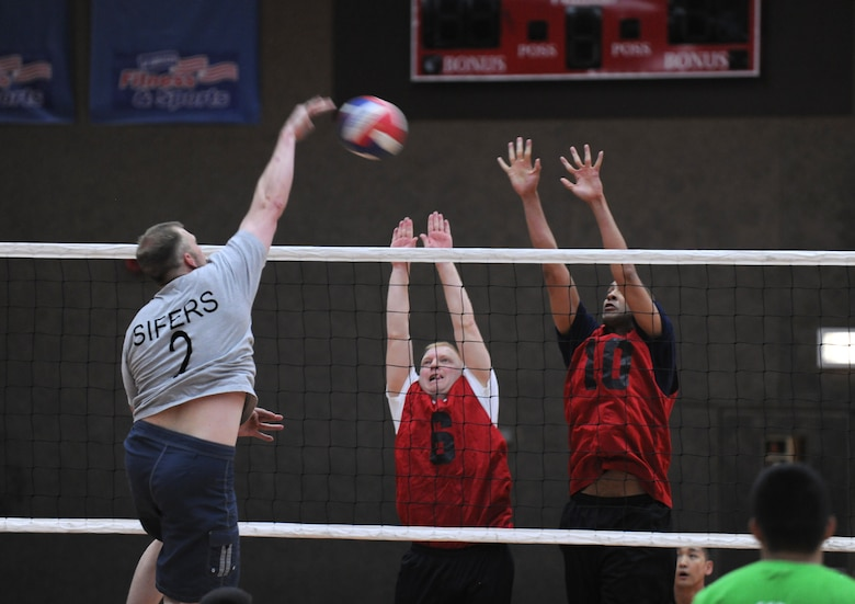 SPANGDAHLEM AIR BASE, Germany – Eric Sifers, 52nd Civil Engineer Squadron, spikes the ball as 52nd Medical Group defenders attempt to block the shot during the intramural volleyball championship series here May 9. The CES defeated MDG 25-16, 19-25, 15-10 to become the intramural volleyball champions. (U.S. Air Force photo/Senior Airman Nathanael Callon)