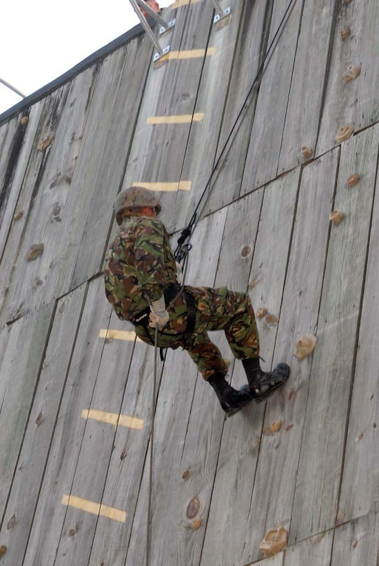 A soldier with the Bermuda Regiment rappels down a tower during a training operation as part of Exercise Bermuda Warrior aboard Marine Corps Base Camp Lejeune, May 4. Approximately 180 Bermuda Regiment soldiers conducted a two-week training exercise aboard the base in a multitude of operation areas, part of their annual abroad training.