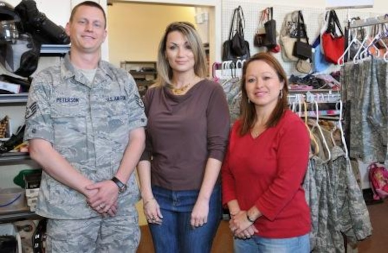 (Left to right) Staff Sgt. Nathan Peterson visits Kirtland Air Force Base Airman's Attic Director Misty Hauge and Assistant Director Christie Wert. Sergeant Peterson developed the Airman's Attic Directory website that serves as a focal point for information about host base's Airman's Attics.
