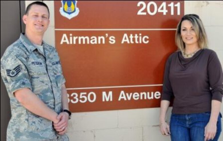 Staff Sgt. Nathan Peterson and Misty Hauge, Kirtland Air Force Base Airman's Attic Director, stand outside the base Attic store. Sergeant Peterson volunteered his time and expertise as a systems administrator with the Air Force Operational Test and Evaluation Center to design the Airman's Attic Directory website.