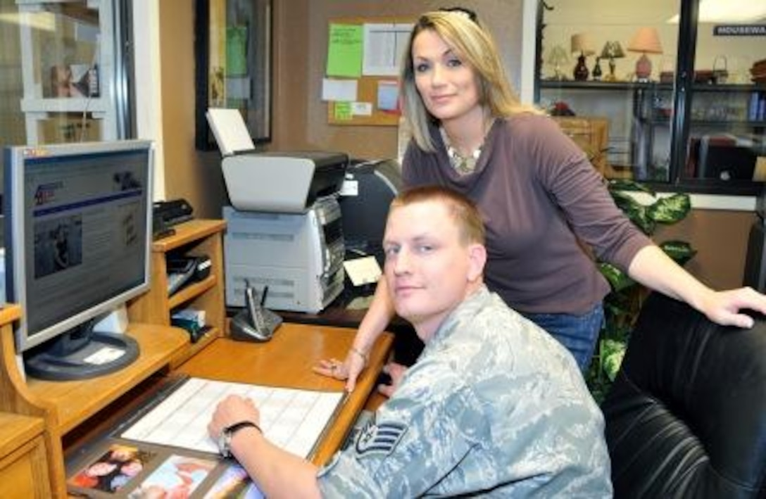 Staff Sgt. Nathan Peterson demonstrates the features of the Airman's Attic Directory website to Misty Hauge, Kirtland Air Force Base, N.M., Airman's Attic Director. The website is designed to be a one stop shop for information about Airman's Attics across the Air Force.