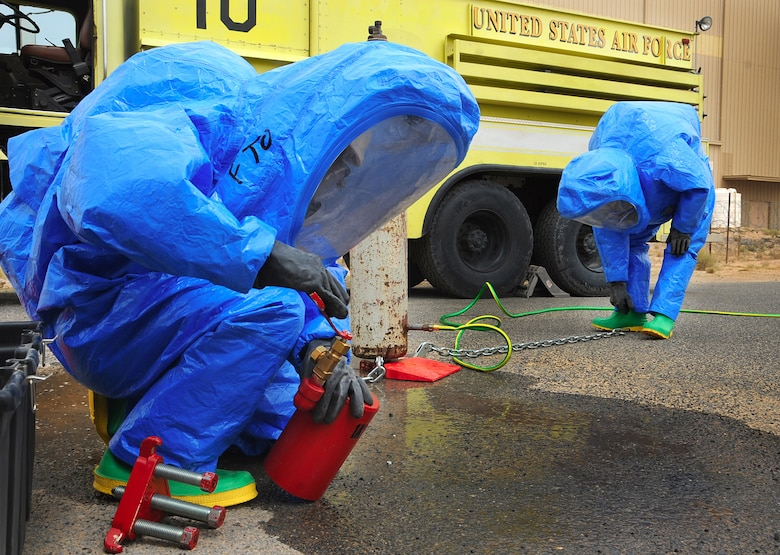 A firefighter with the 386th Expeditionary Civil Engineer Squadron at an air base in Southwest Asia prepares a cap to seal a leaking valve during a hazardous material technical training exercise. It is a Department of Defense requirement that all Air Force firefighters be certified to the hazmat technical level. (U.S. Air Force photo/Senior Airman Cynthia Spalding)