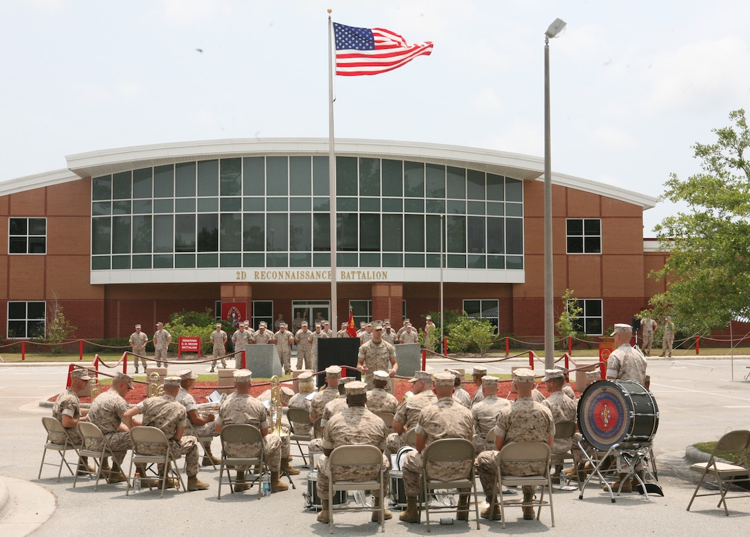 The 2nd Marine Division Band prepares to play the national anthem during the rededication ceremony, May 13, 2011. The monument honors the Marines of Force Reconnaissance Company who have paid the ultimate sacrifice over the past 50 years.
