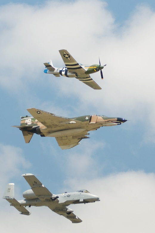 A P-51 Mustang, an F-4 Phantom and an A-10 Thunderbolt II fly together in a Heritage Flight over the 2011 Defenders of Liberty Air Show at Barksdale Air Force Base, La., May 7-8. Heritage Flights offer attendees a rare opportunity to see historic and modern aircraft in formation together. (courtesy photo by Mr. Chris Reich)