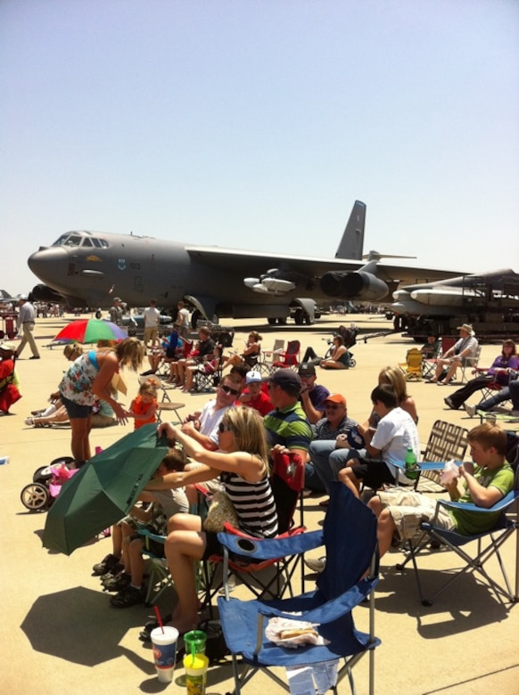 Spectators at the 2011 Defenders of Liberty Air Show at Barksdale Air Force Base, La., set up chairs and umbrellas around or under static aircraft in order to enjoy the aerial demonstrations throughout the day. (courtesy photo by Mr. Doug Maiden, 2nd Civil Engineer Squadron)