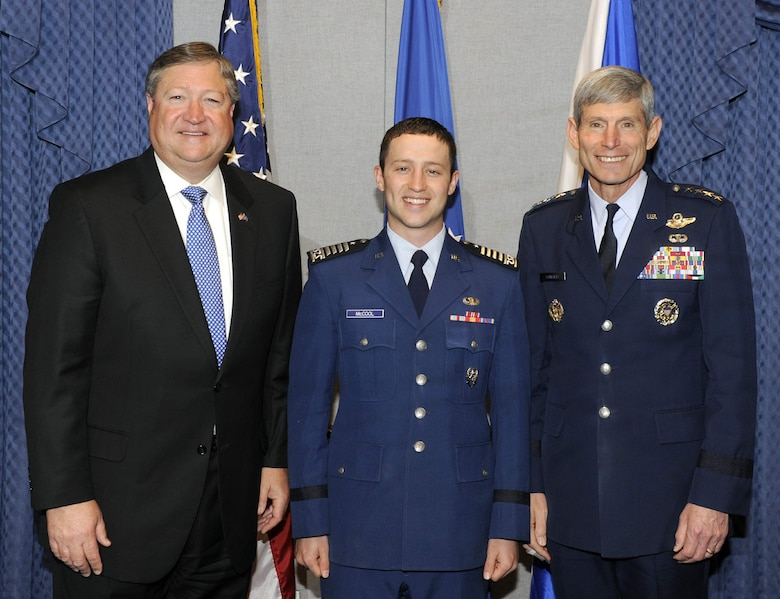 Secretary of the Air Force Michael Donley, Air Force Academy Cadet Christopher J. McCool and Air Force Chief of Staff Gen. Norton Schwartz stand for a photo during the 2010 U.S. Air Force Cadet of the Year ceremony May 12, 2011, at the Pentagon. Cadet McCool earned the honor for demonstrated excellence in military skill, academics and athletics in an Air Force commissioning program. (U.S. Air Force photo/Andy Morataya)