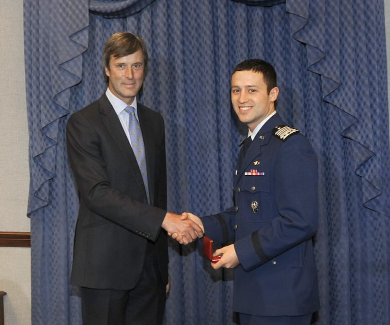 Marcus De Ferranti presents a gift to Air Force Academy Cadet Christopher J. McCool during a ceremony May 12, 2011, at the Pentagon. The ceremony was held to honor Cadet McCool, the 2010 U.S. Air Force Cadet of the Year. Mr. Ferranti was representing the Air Squadron, a private British organization that established the award in 2000 to pay tribute to the U.S. military for its support of the United Kingdom over the years. (U.S. Air Force photo/Andy Morataya)