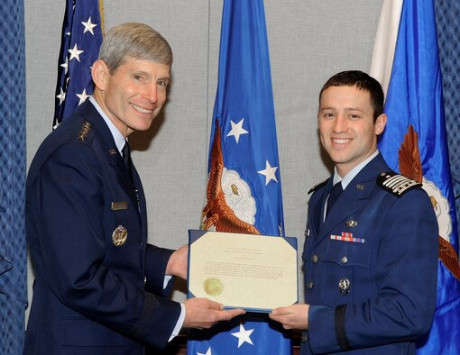 Air Force Chief of Staff Gen. Norton Schwartz presents the 2010 U.S. Air Force Cadet of the Year award to Air Force Academy Cadet Christopher J. McCool during a ceremony May 12, 2011, at the Pentagon. Cadet McCool earned the honor for demonstrated excellence in military skill, academics and athletics in an Air Force commissioning program. (U.S. Air Force photo/Andy Morataya)