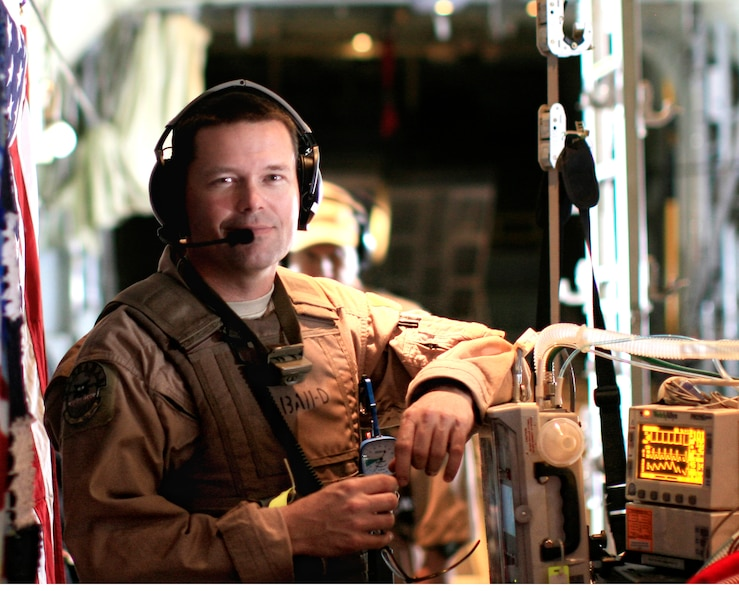 Tech. Sgt. Matthew Blonde pauses during a typical day at the 'office.'  Sergeant Blonde, 452nd Aeromedical Staging Squadron, is a member of the Critical Care Aeromedical Transport Team and a full-time, civilian respiratory therapist.  (Photo courtesy of TSgt. Matt Blonde)