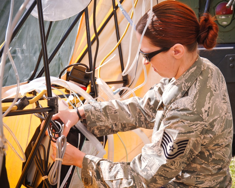 """U.S. Air Force Tech Sergeant Lisa Shivery from the 163rd Medical Squadron operates a respiratory system attached to one of the tents where she and other Airmen volunteered during """"Operation Medical Shelter,"""" a simulated disaster training exercise on May 11, 2011 at Freedom Park in Camarillo, California. (U.S. Air Force photo by Airman 1st Class Nicholas Carzis/Not Released)"""