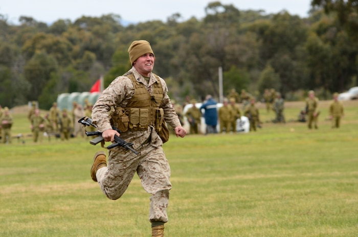 Sgt. Joshua Martin, competitor, Combat Shooting Team, Weapons Training Battalion, Marine Corps Base Quantico, runs to the firing point during a timed match May 15 at the 2011 Australian Army Skill at Arms Meeting.  The meeting is an annual, international combat-marksmanship competition hosted by the Australian Army that will run through May 19.  (U.S. Marine Corps Photo by Lance Cpl. Mark W. Stroud/Released)