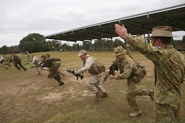 Australian Army Maj. Gen. David Morrison (right), commanding general, Forces Command, orders a bayonet charge here May 15 during the 2011 Australian Army Skill at Arms Meeting (AASAM).  The charge was carried out by Marines with Marine Shooting Detachment Austral