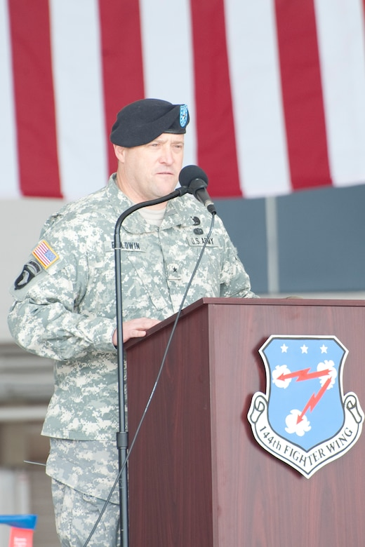 Brig. Gen. David S. Baldwin, The Adjutant General, California National Guard, speaks in front of the 144th Fighter Wing during a recent Change of Command Ceremony held in Fresno, Calif. on May 14, 2011.  The ceremony allows the unit to witness their new leader, Col. Sami D. Said, assume his dutiful position as the Wing Commander.  (U.S. Air Force photo by Master Sgt. David Loeffler/released)